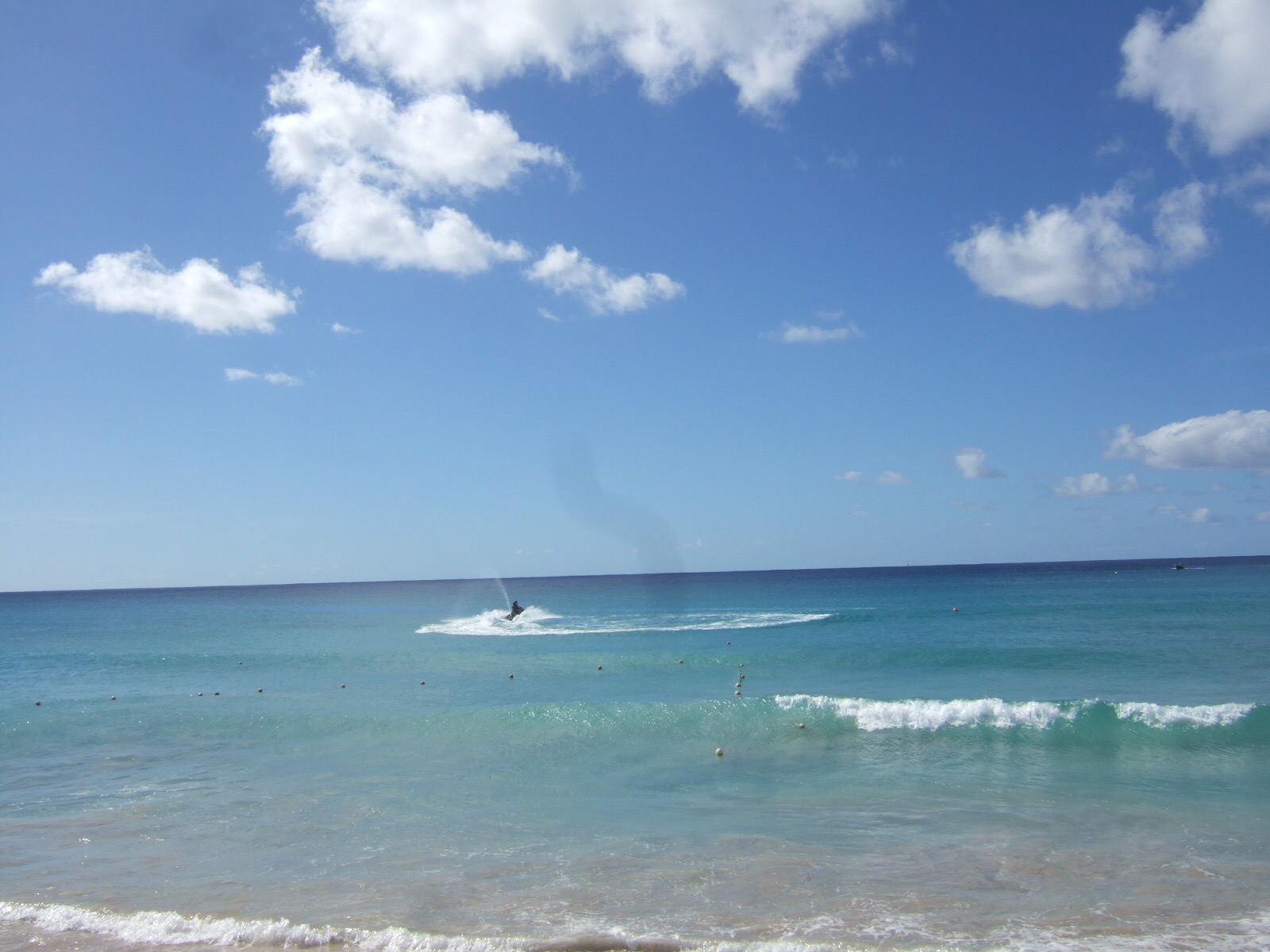 A jet ski in the turquoise waters of Rockley Accra Beach, Barbados