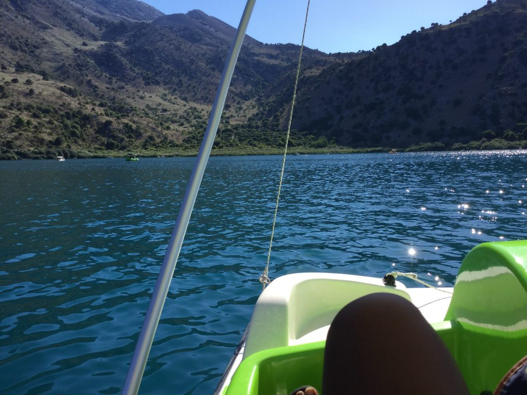 Paddle boating solo in Lake Kournas, in Crete